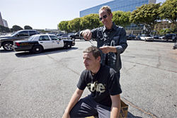 Freese gives a fan a slight trim in the parking lot of the Long Beach Courthouse.