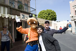 Goofy, fan Ferris Al-Sayed, and Freese during the $5,000 private tour of Disneyland package.