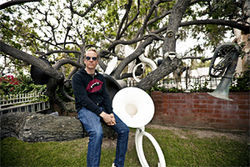 Josh Freese with the Tuba Tree his father started 18 years ago.