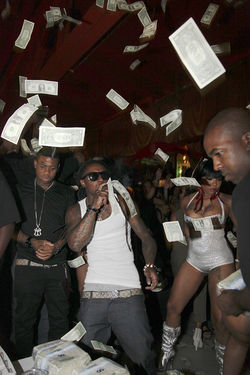 Lil Wayne rains dollar bills at the club.