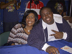 Kingston and his mother pose during a CD signing at the BankAtlantic Center in Sunrise.
