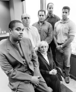They all worked at Lexus of Kendall, and they all say it was awful (from left): Lance Noel, Avraham Mardo, Jesus Molina, Humfredo Perez, Felix Quevedo, Susan Weinberg