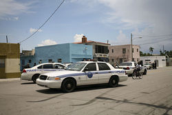 A squad of Miami Police officers intercepts a suspected thief on NW 15th Avenue.