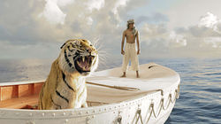 Pi Patel (played by Surah Sharma) and a fierce Bengal tiger named Richard Parker must rely on each other to survive in Life of Pi.