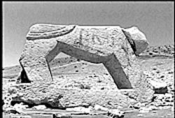 Stone lion in the Iranian desert