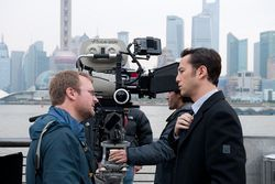 Rian Johnson (left) with Joseph Gordon-Levitt on the set of Looper.
