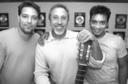 Cogs in the machine: Roberto Blades (left) and Jon Secada flank Estefan