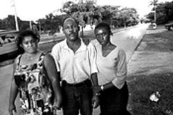 Catherine and Ernest Chery, along with Catherine's half-sister Shay Tropnas (right), maintain a memorial to Watson at the North Miami street corner where he was gunned down