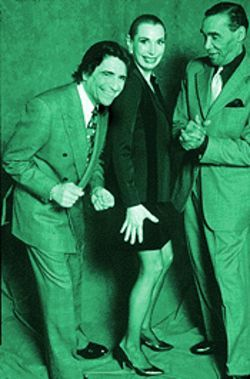 "Edward Villella (left) and ""Cuban Pete"" Aguilar surround Aguilar's dance partner Barbara Craddock"