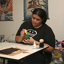 West Palm Beach's Melissa Soler paints a Jango Fett figure.