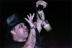 "Michael Trixx, a.k.a. Michael Costa, levitates a Budweiser to one of his rock and roll favorites, AC/DC's ""Have a Drink on Me"""