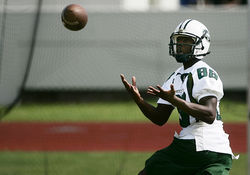 Miami Central wide receiver Durell Eskridge catches a pass in practice.