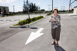 Barbara Hagen stands in the empty park-and-ride lot on Miami Gardens Drive that cost taxpayers $1.8 million.