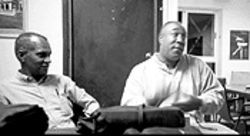 Broadcaster Jorge Petinaud Martinez and Osmel Francis Turner, of Cubanos en la Red, chat at Radio Metropolitana during Petinaud's program La Esquina del Rap
