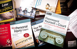 Just a few of the books Eddie has used to file his 31 lawsuits.