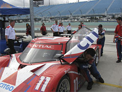 The CITGO/SAMAX team pushes #11 out of the pit after placing fourth