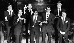 Mitt Romney (center) when he worked at Bain Capital.
