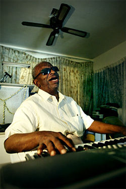Jimmy Kay at home  on his keyboard