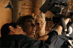 Sebastian Ligarde and Sonya Smith watch a playback from a  scene together