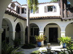 Shapiro's Bay Road mansion offered 180 degree views of Biscayne Bay in back, and a shady courtyard in front.