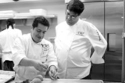 Celeb chef Doug Rodriguez (right) spends some time  supervising the troops