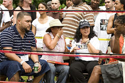 Spanish-language TV celebrity Ana Polo and Martinez's mom watch his most recent back-yard fight.