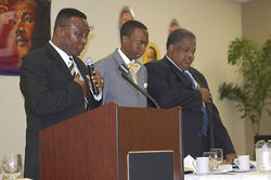 Former Homestead mayor Roscoe Warren (left), an unnamed youth, and Mayor Otis Wallace at a Martin Luther King Day ceremony.
