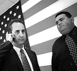 In a district designed for himself, Mario Diaz-Balart (left), with campaign manager Miguel Otero, exploited the anti-Castro fixation when absolutely necessary