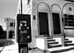 Telltale sign the buidling is owned by landlord Raymond Navarro: Pay phone out front