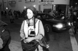 Ronna Gradus, a freelance photographer with the Miami Herald during the FTAA, is locked and loaded for her embedded assignment