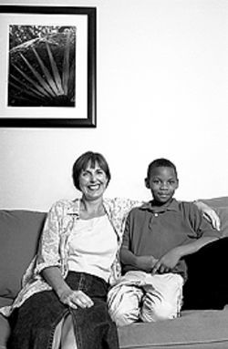 Nine-year-old Emmanuel Teagan, Oscar's best friend, with his mom, Tracy