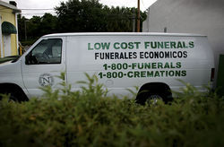 Alkhalifa's white van, parked at Funeraria Latina Nacional, advertises his business.