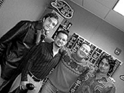 Fuego Rock&#039;s Kike Posada (second from right) embraces Grammy-nominated Bacilos