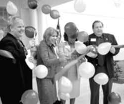 Watch out, Marta! Those ribbon-cutters also are handy backstabbers. Perez opens a new school building with Jacqueline Pepper and superintendent Roger Cuevas.