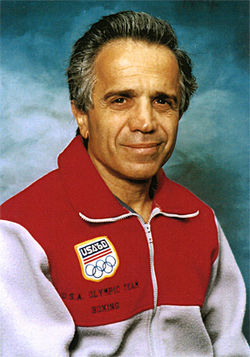 Nicholas Spanakos wearing his team jacket from the 1960 Rome Olympics.
