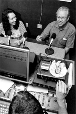 Jeff White's wife, Tais, and client Pedro Penaranda record a  program in WRMI's Fontainebleau Park studio, a spot  frequented by disgruntled expatriates