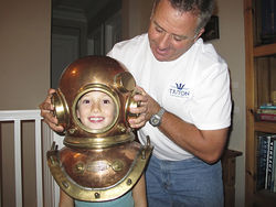 Patrick Lahey puts an old-fashioned diving suit on his daughter, Victoria.