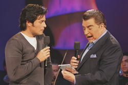 Don Francisco and frequent guest Chayanne (left).