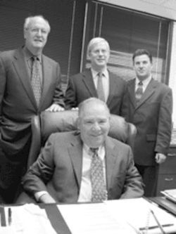 Criminal-defense law partners Don Bierman (sitting), Ed Shohat (left), Ira Loewy, and Michael Pizzi, Jr.