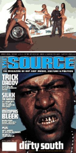 Trick Daddy makes a new friend during his Source cover shoot