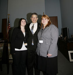 The suicide of Tammy Aaberg's (right) son Justin inspired Sen. Al Franken (center) to pen the federal Student Non-Discrimination Act.