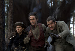 Noomi Rapace (left), Robert Downey Jr., and Jude Law in Sherlock Holmes: A Game of Shadows.