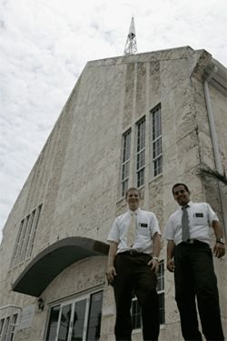Elders Matthew Bean (left) and Ademir Cacique stand  outside a three-million-dollar Miami Beach Mormon  sanctuary