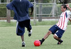 On a recent Monday afternoon, Ademir Cacique gets in a game of soccer with a fellow elder