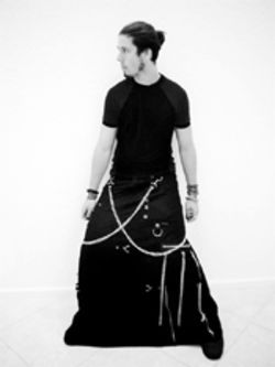 Lior Gonda makes like that French dude from  Highlander in skirt and chains