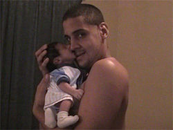 Hipolito Hernandez with his son, Saul, just weeks after the boy's birth.