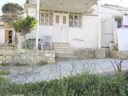 After Israeli settlers moved into the Hamdallah house, they divided their quarters from the Hamdallahs' with barbed wire.