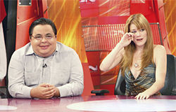 Carlucho smiles and Gelet Martínez, a La Cosa Nostra regular, dabs away tears after a taped segment showing the host and a five-year-old who was alleged to be his son.