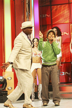 "Boncó dances with Enrique Divine, a Venezuelan singer who often inspires producers to play ""YMCA"" during the show."