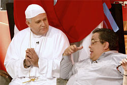 Carlucho and the pope get down to it.
